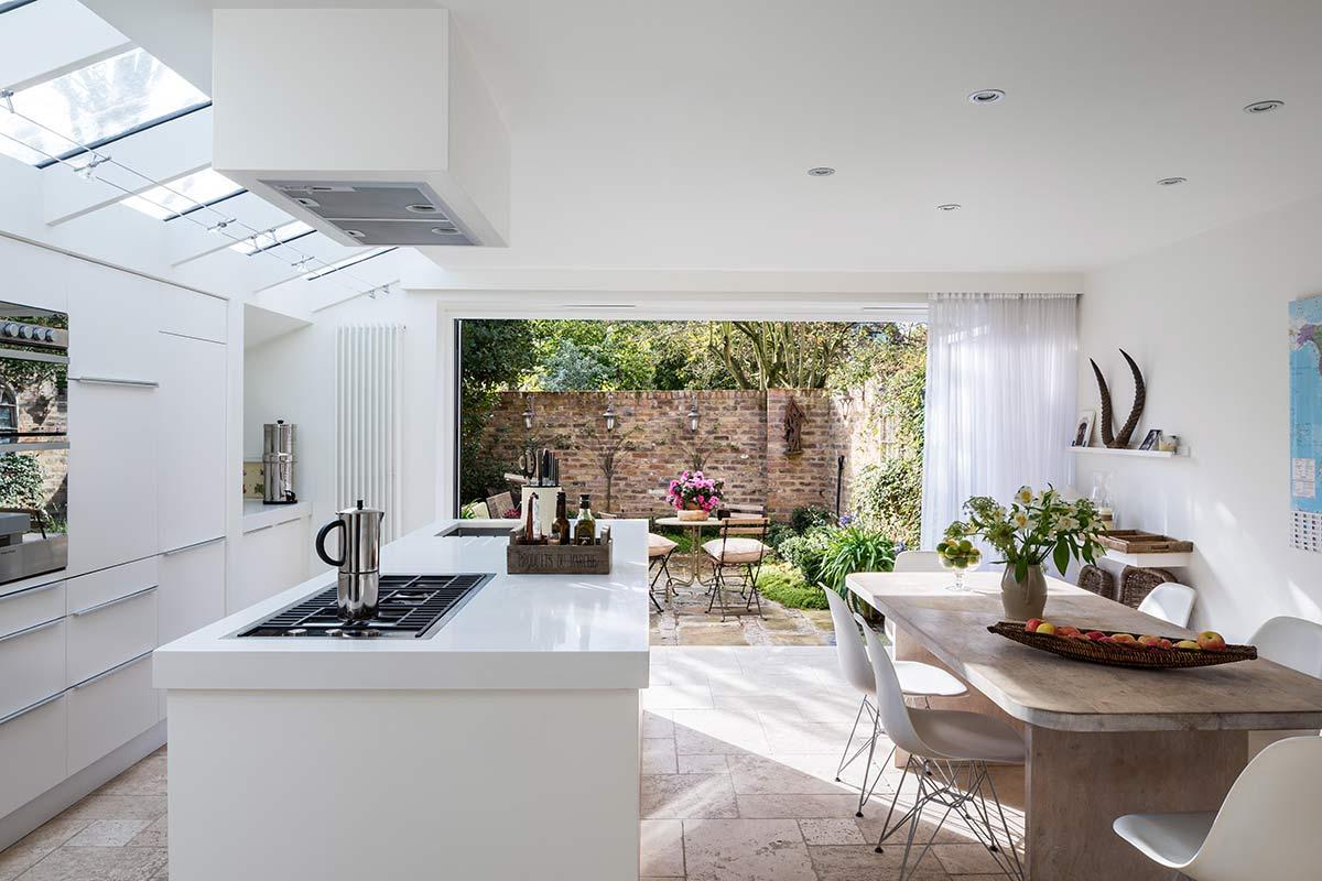 aluminium bifold doors for kitchen extension and garden view by Bi Fold Doors UK