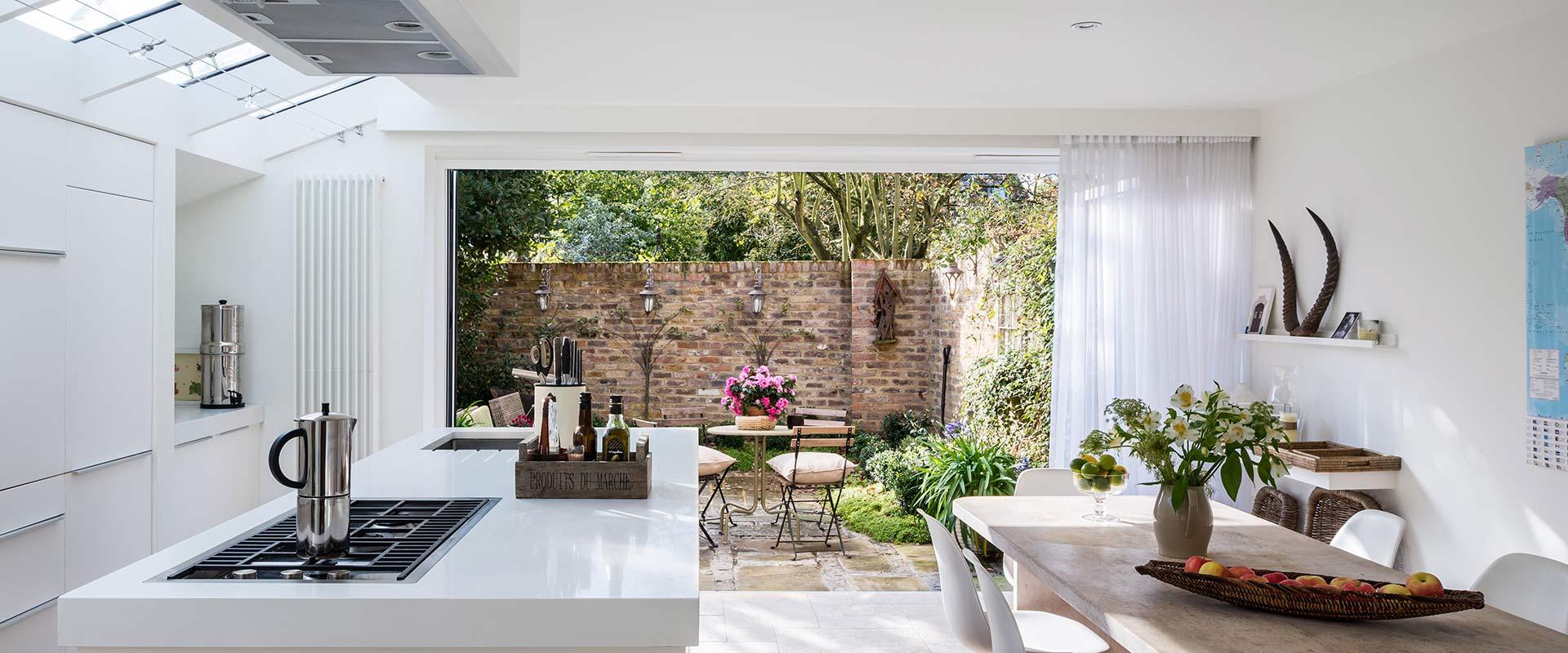 garden view of aluminium bifold doors for kitchen extension by Bi Fold Doors UK