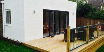 house extension decking bifold doors