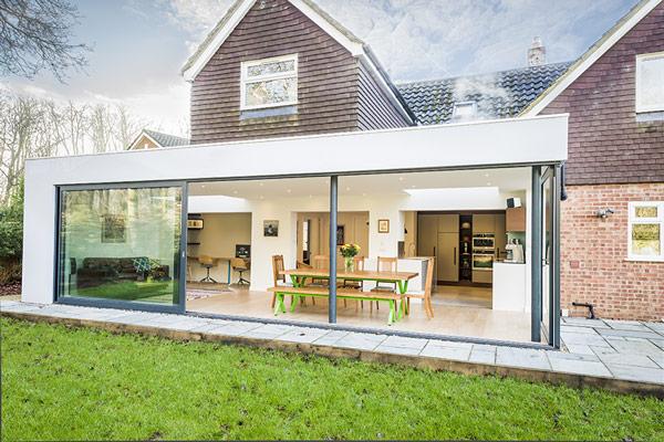 house kitchen extension with grey aluminium sliding doors