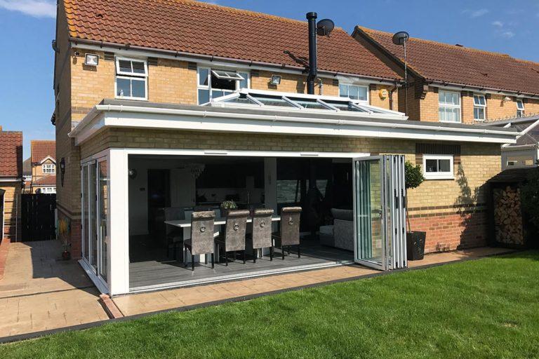 orangery extension with white aluminium bifold doors in Maidstone