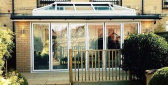 orangery house extension with white bi-fold doors