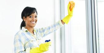 woman cleaning bi fold doors